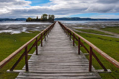 Old dock linking to an isolated island, Chiloé Is Royalty Free Stock Photography