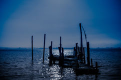 Old dock moon light reflection Royalty Free Stock Photos