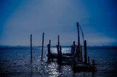 Old dock moon light reflection Royalty Free Stock Photos
