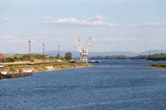 Old dock with portal cranes on Danube Royalty Free Stock Photography