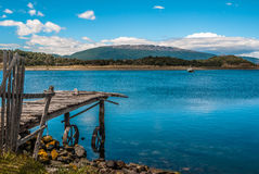 Old dock waiting for a ship in Ushuaia. Argentina Royalty Free Stock Photos