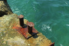 The old docking port. Docking port of on the quay in Foros, Crimea. close-up Stock Images