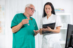Old doctor and a nurse are consulted Stock Image