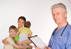 Old doctor and patients royalty free stock photography