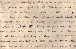 Old document. Fragment of script from an old legal document written on parchment stock image