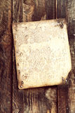 Old document on wood Stock Photo