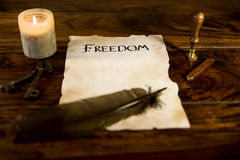 Old document with the word freedom Stock Photo