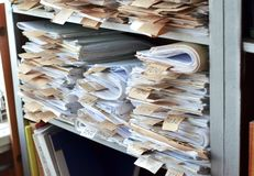 Old documents, drawings with numbers stacked on shelves in the o. Old documents, drawings with numbers stacked on shelves in office stock photography