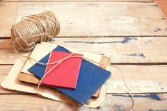 Old documents with rope. On wooden background royalty free stock image