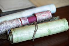 Old documents. Various old scrolled documents on a shiny table Royalty Free Stock Images