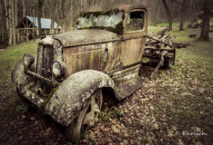 Old Dodge Pickup Truck. Gatlinburg, Tennessee, USA. March 25, 2016 - A 1930's Dodge pick up truck abandoned on a farm with it's load of logs still in place stock photo