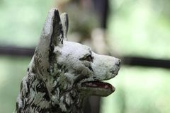 Old dog statue. In the garden Royalty Free Stock Images