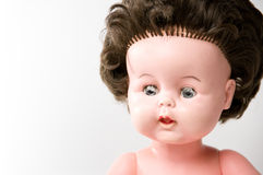 Old doll. Portrait of an old and dirty doll with brown hair Royalty Free Stock Image