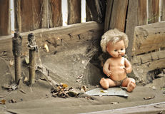 Old doll in an abandoned house Stock Photo