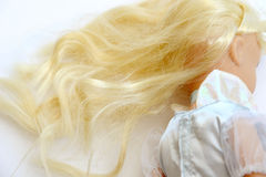 Old doll with blond hair Stock Photo