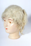 Old doll head. Picture of a old porcelain doll head Stock Photo