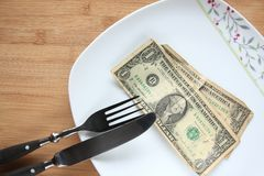 Old dollar banknotes on a plate Stock Photo