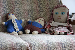 Old dolls. Old handmade dolls on the couch Stock Images