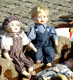 Old dolls. For sale at antiques fair Stock Images