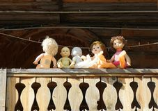 Old dolls of Soviet times on the balcony of a historic building stock image