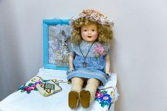 Old dolls. Old vintage antique dolls at an art exhibition royalty free stock image