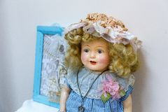 Old dolls. Old vintage antique dolls at an art exhibition stock photos