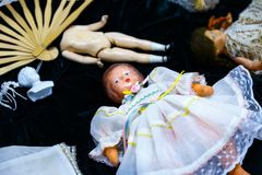 Old dolls. Old vintage antique dolls at an art exhibition royalty free stock photos