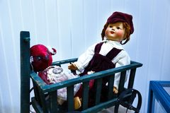 Old dolls. Old vintage antique dolls at an art exhibition royalty free stock photo