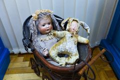 Old dolls. Old vintage antique dolls at an art exhibition royalty free stock images