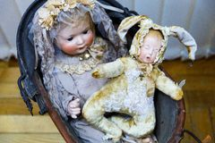 Old dolls. Old vintage antique dolls at an art exhibition stock photo