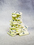 Old dominoes tower on canvas Stock Photography