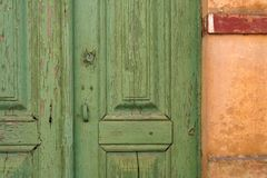 Old Door. Green Old Door and yellow wall Royalty Free Stock Photos