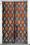 Old door. With patterns, closed, brown Stock Image