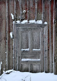 Old door. Old snowy door. This is a typical Swedish storehouse with a nordic door design stock images