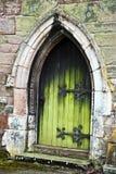 Old Door. Old gothic hinged green door Stock Photography