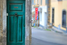 Old door. Photo of facade oh old house with green door and view on the street royalty free stock photo