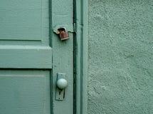 Old Door. Old green door and padlock Stock Photo