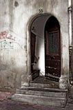Old door. Old ravaged door with doorstep Royalty Free Stock Photos