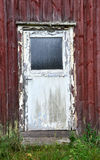 Old door. With peeling paint stock photography