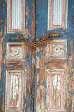 Old door. With rusty chains and flaking paint Stock Image