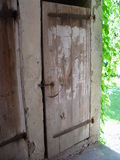 Old door. Behind the house Royalty Free Stock Photos