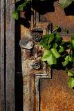 Old door. Old, rusty door of the cemetery Royalty Free Stock Image