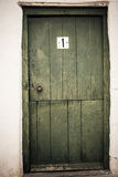 Old door. The little white house with a old grungy green door Royalty Free Stock Images