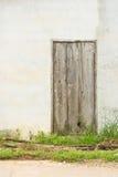 Old door. Old gray door on the Wall Stock Photos