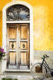 Old door. Old wooden door and a bike at a house in italy (tuscany Royalty Free Stock Photos