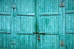 Old door. Old wooden shed gate with faded paint Royalty Free Stock Photos