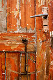 Old door. Very old door with hook. The hook made that long scratch at the bottom of foto Stock Photography