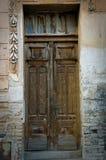 Old door. Old broken, damaged door on the classic building stock photos