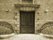 Old door. Entrance door with ornate stonework in a very old building (1824 Stock Images