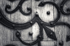 Old door. Old wooden door with iron adornments Stock Photo